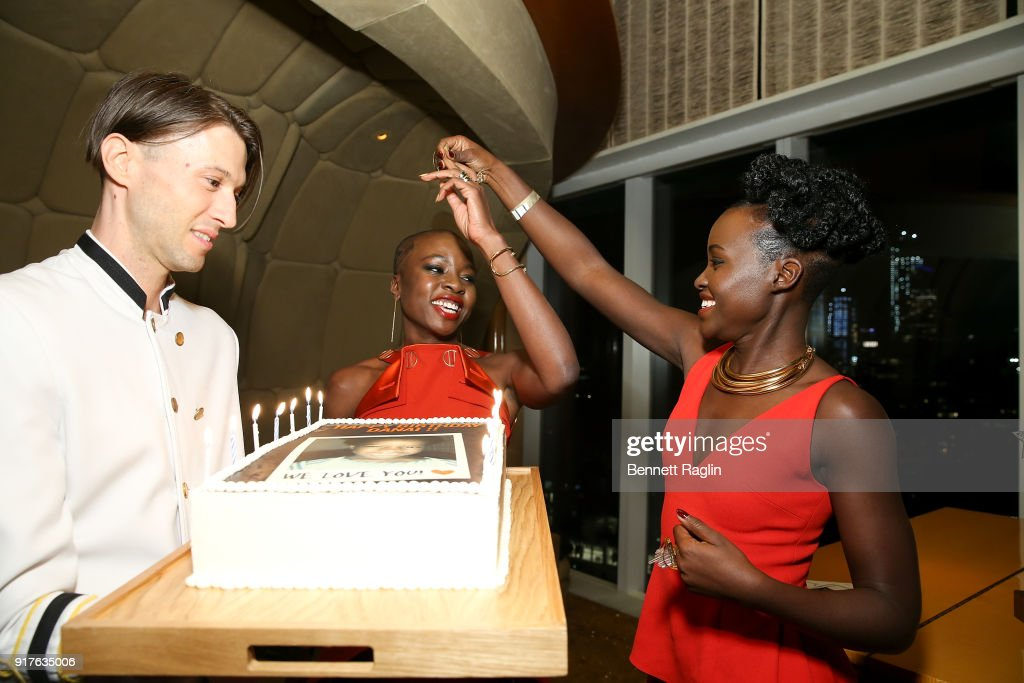 Actress Danai Gurira blows out the candles on her birthday cake as Lupita Nyong'o looks on during the DANAI x One x Love Our Girls celebration at The Top of The Standard on February 12, 2018 in New York City.