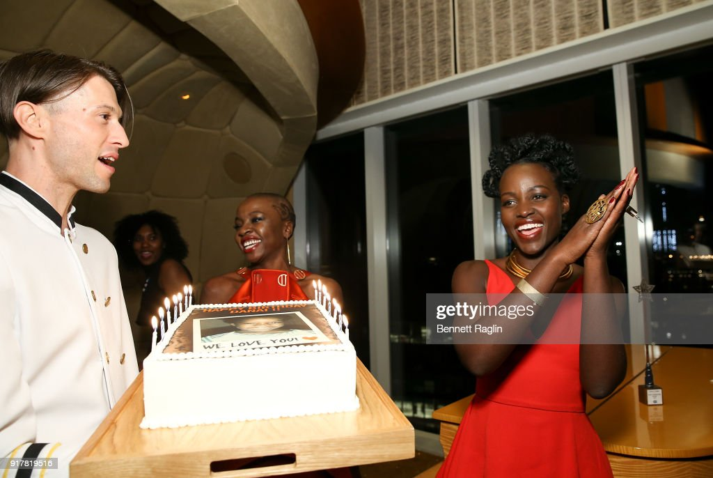 Actress Danai Gurira blows out the candles on her birthday cake as Lupita Nyong'o (R) looks on during the DANAI x One x Love Our Girls celebration at The Top of The Standard on February 12, 2018 in New York City.
