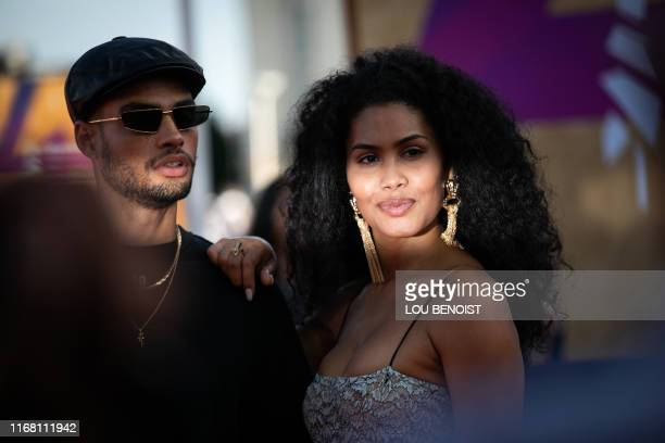 US actress dancer and activist Leyna Bloom poses with a guest on the red carpet as part of the 45th US film Festival of Deauville Normandy on...