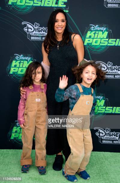Actress Dania Ramirez and family attend the world premiere of Disney channel original movie 'Kim Possible' in North Hollywood California on February...