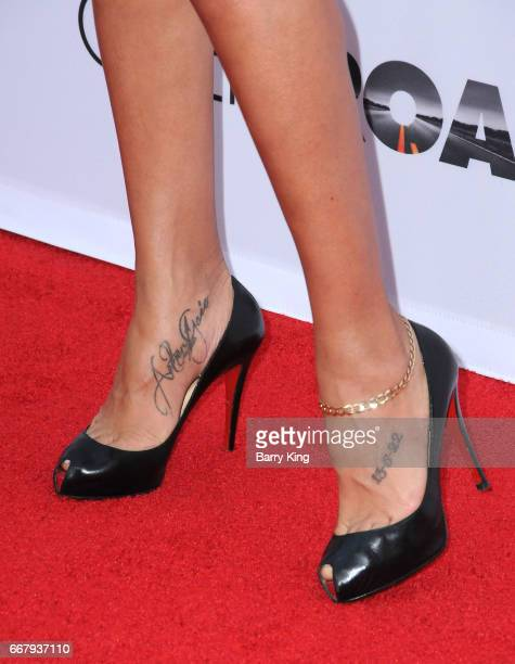 Actress Dania Ramirez shoe and tattoo detail attend premiere of Open Road Films' 'The Promise' at TCL Chinese Theatre on April 12 2017 in Hollywood...
