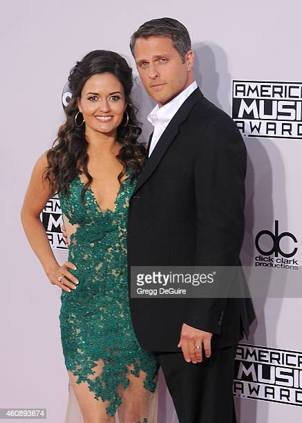 Actress Danica McKellar and husband Scott Sveslosky arrive at the 2014 American Music Awards at Nokia Theatre LA Live on November 23 2014 in Los...