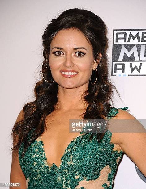 Actress Danica McKellar poses in the press room at the 2014 American Music Awards at Nokia Theatre LA Live on November 23 2014 in Los Angeles...