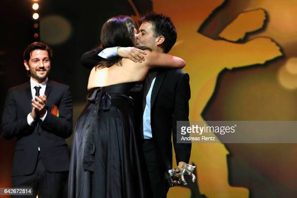 Actress Daniela Vega embraces film director Sebastian Lelio on stage after he wins Silver Bear for Best Screenplay for Una Mujer Fantastica at the...