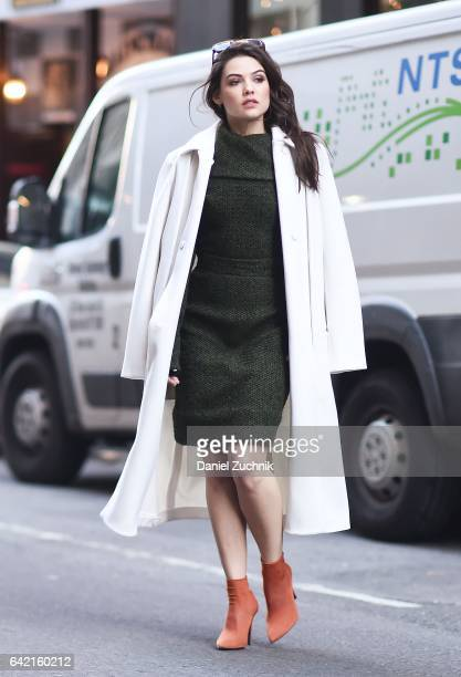 Actress Danielle Campbell is seen on the streets of Manhattan wearing a Ports 1961 coat Concepto top and skirt Zara shoes and Dax Gabbler sunglasses...