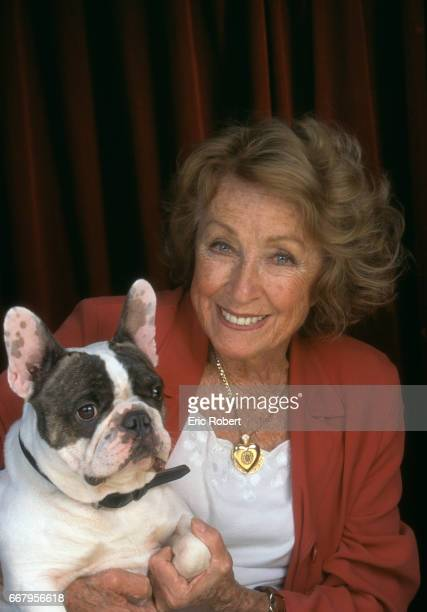 Actress Danielle Darrieux with Her Boston Terrier