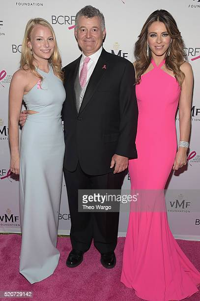 Actress Danielle Lauder businessman William Lauder and actress Elizabeth Hurley walk the red carpet at the Breast Cancer Research Foundation's Hot...
