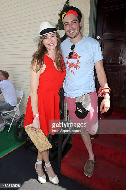 Actress Danielle Panabaker and actor Ben Feldman attend Crab Cake LA on August 2 2015 in Los Angeles California