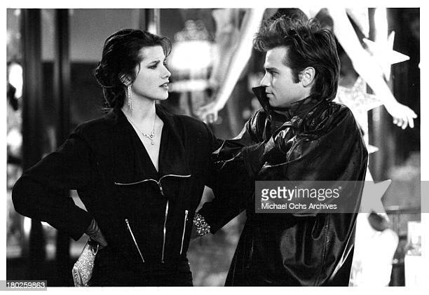 Actress Daphne Zuniga and actor Clayton Rohner on set of the Atlantic Releasing movie Modern Girls in 1986