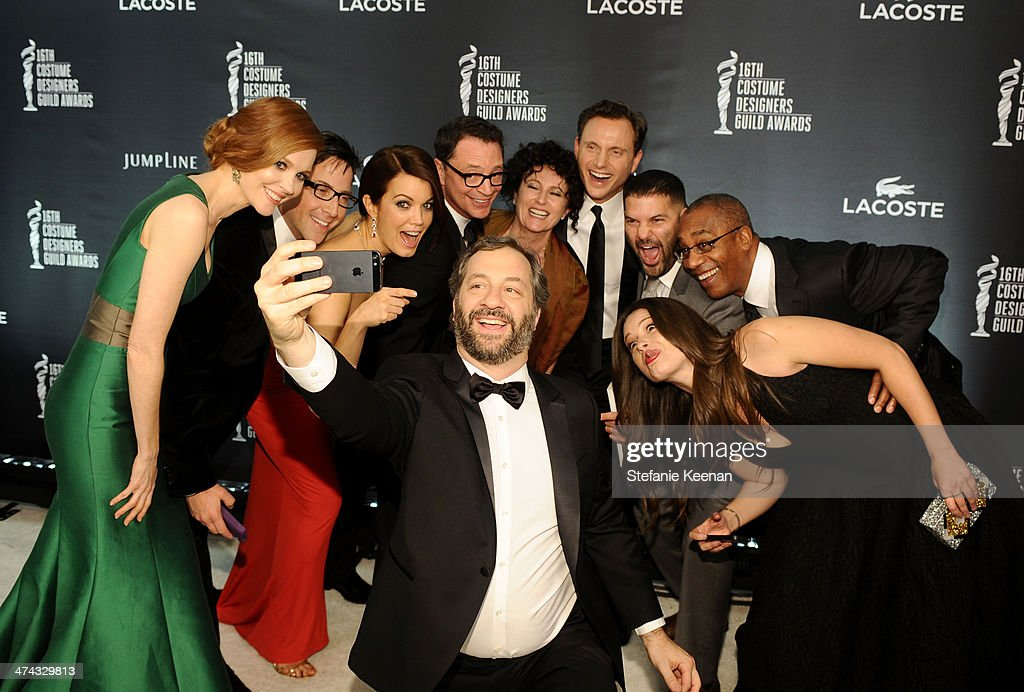 Actress Darby Stanchfield, actor/writer Dan Bucatinsky, actress Bellamy Young, host Joshua Malina, director Judd Apatow, costume designer Lyn Paolo, actor Tony Goldwyn, actor Guillermo Diaz, actor Joe Morton and actress Katie Lowes attend the 16th Costume Designers Guild Awards with presenting sponsor Lacoste at The Beverly Hilton Hotel on February 22, 2014 in Beverly Hills, California.