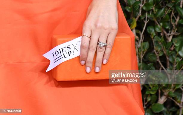 US actress D'Arcy Carden holds a tag reading Time's Up as she arrives for the 76th annual Golden Globe Awards on January 6 at the Beverly Hilton...