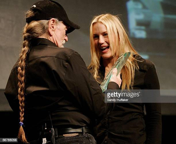 Actress Daryl Hannnah laughs with Singer/Actor Willie Nelson after he recieved an award at the Sustainable Biodiesel Summit at the San Diego...