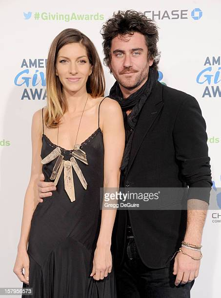Actress Dawn Olivieri and boyfriend Bryn Mooser arrive at the 2nd Annual American Giving Awards at the Pasadena Civic Auditorium on December 7 2012...