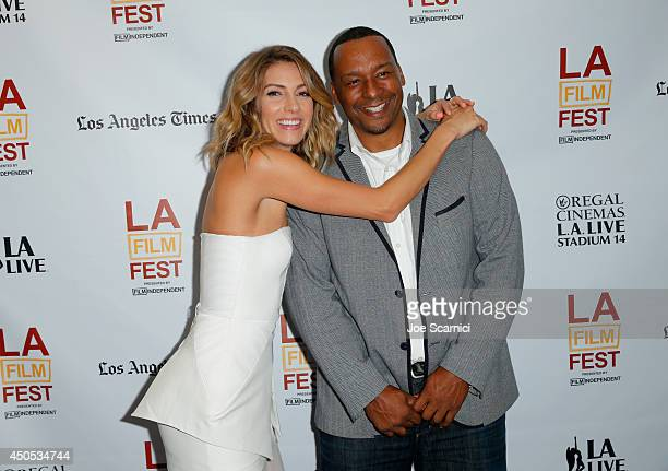 Actress Dawn Olivieri and director Deon Taylor attend the Supremacy premiere during the 2014 Los Angeles Film Festival at Regal Cinemas LA Live on...