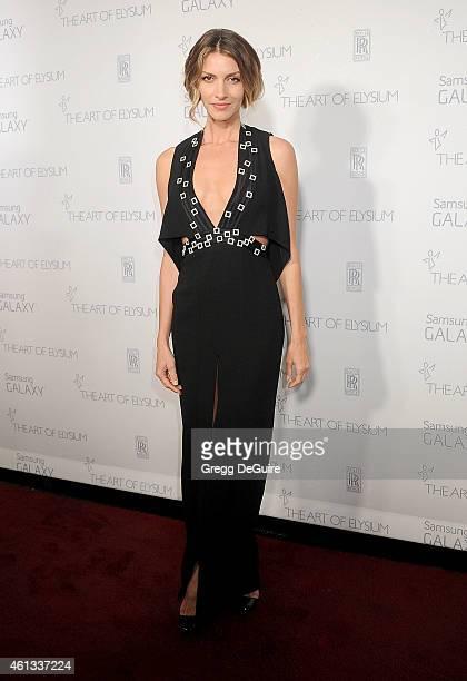Actress Dawn Olivieri arrives at The Art Of Elysium's 8th Annual Heaven Gala at Hangar 8 on January 10 2015 in Santa Monica California