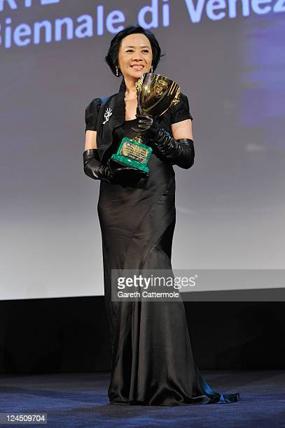 Actress Deanie Yip of the film A Simple Life accepts the Coppa Volpi for Best Actress at the Closing Ceremony during the 68th Venice Film Festival at...
