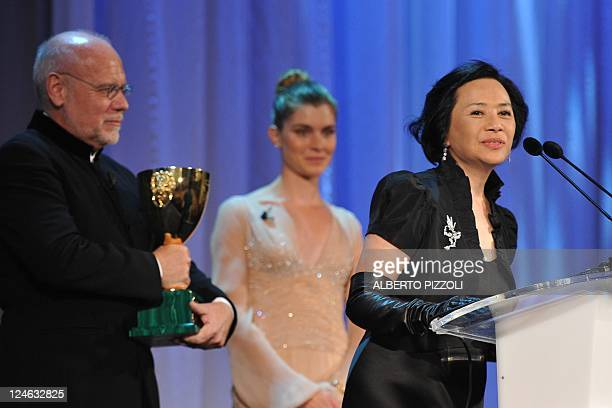 """Actress Deanie Yip speaks before receiving the Volpi Cup for best actress for """"Tao Jie """" from the Venice Film Festival Marco Mueller during the award..."""
