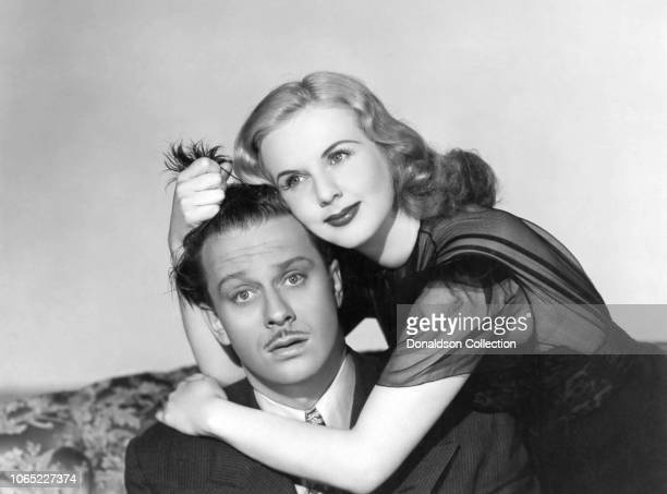 Actress Deanna Durbin and David Bruce in a scene from the movie Lady on a Train