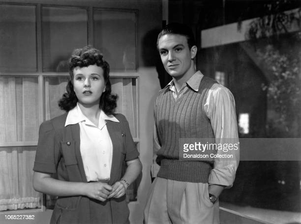 Actress Deanna Durbin and Robert Stack in a scene from the movie Nice Girl