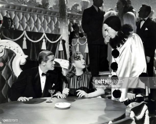 Actress Deanna Durbin Dan Durea and Lash La Rue in a scene from the movie Lady on a Train