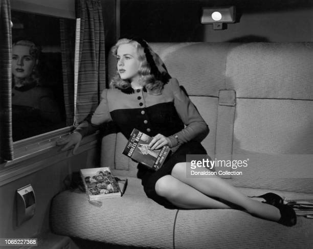 Actress Deanna Durbin in a scene from the movie Lady on a Train