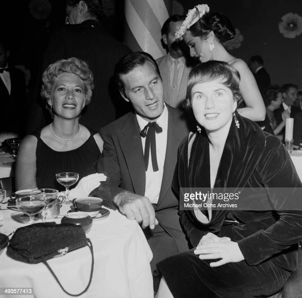 Actress Deanna Durbin with Dinah Shore and George Montgomery at dinner at Mocambo's in Los Angeles California