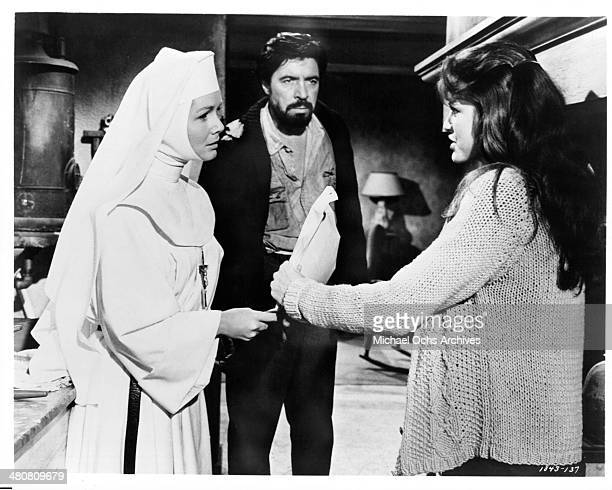 Actress Debbie Reynolds actor Michael Pate and actress Katharine Ross in a scene of the movie The Singing Nun circa 1966