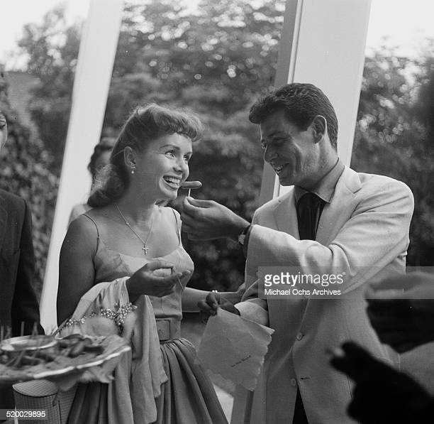 Actress Debbie Reynolds and Eddie Fisher attend a party in Los AngelesCA