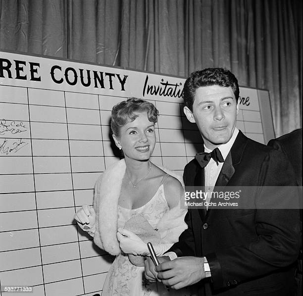 """Actress Debbie Reynolds and Eddie Fisher attend the movie premiere of """"Rain Tree"""" in Los Angeles,CA."""