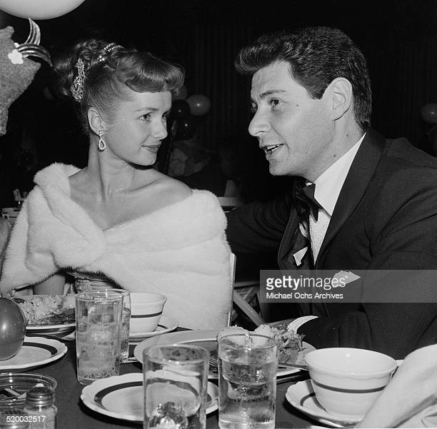 """Actress Debbie Reynolds and Eddie Fisher attend the movie premiere party for """"Trapeze"""" in Los Angeles,CA."""