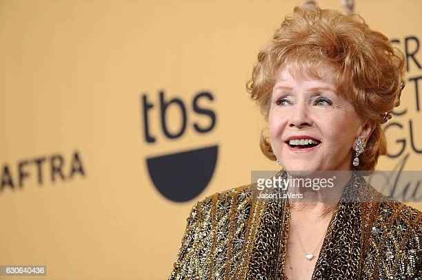 Actress Debbie Reynolds poses in the press room at the 21st annual Screen Actors Guild Awards at The Shrine Auditorium on January 25 2015 in Los...