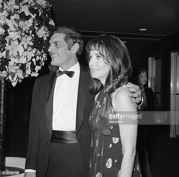 Actress Debbie Reynolds president of the Thalians a Hollywood charity organization greets actor Omar Sharif and actress Anjanette Comer at the 13th...