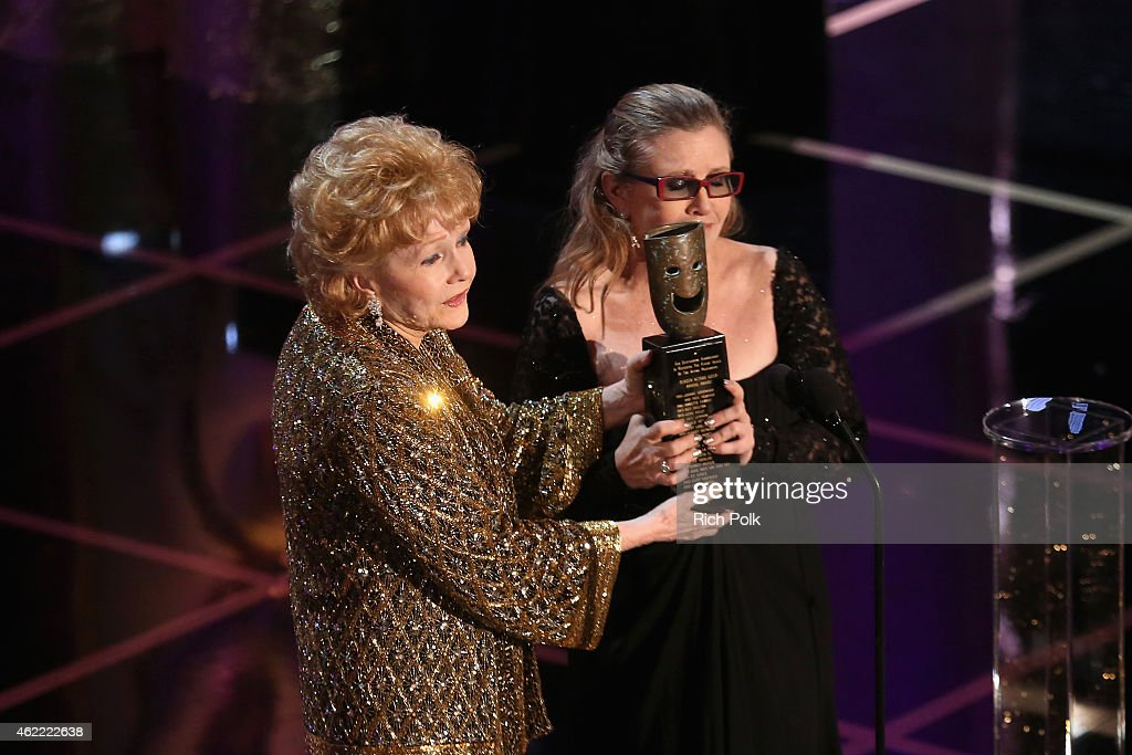 Actress Debbie Reynolds (L), recipient of the Lifetime Achievement Award and actress Carrie Fisher speak onstage at TNT's 21st Annual Screen Actors Guild Awards at The Shrine Auditorium on January 25, 2015 in Los Angeles, California. 25184_020