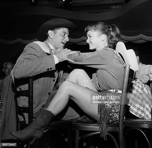 Actress Debbie Reynolds talks to a friend after her performance in Los AngelesCA