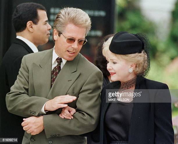Actress Debbie Reynolds walks with her son as they arrive for the funeral of the legendary entertainer Frank Sinatra at the Good Shepard Catholic...