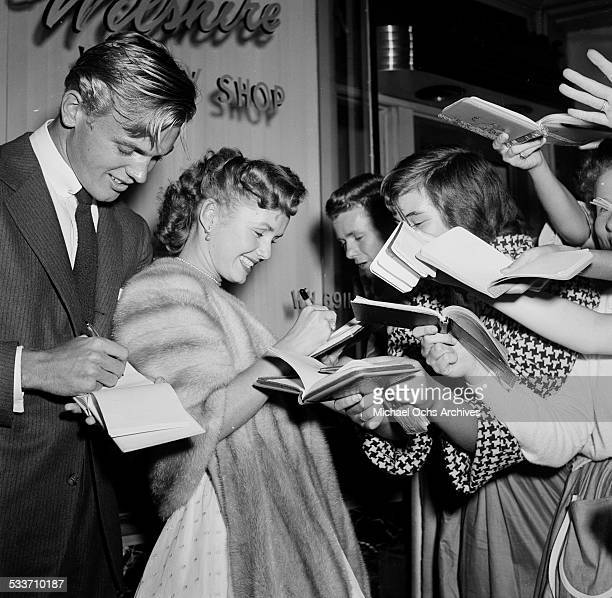 Actress Debbie Reynolds with actor Tab Hunter attend the premiere of 'Little Boy Lost' in Los AngelesCA