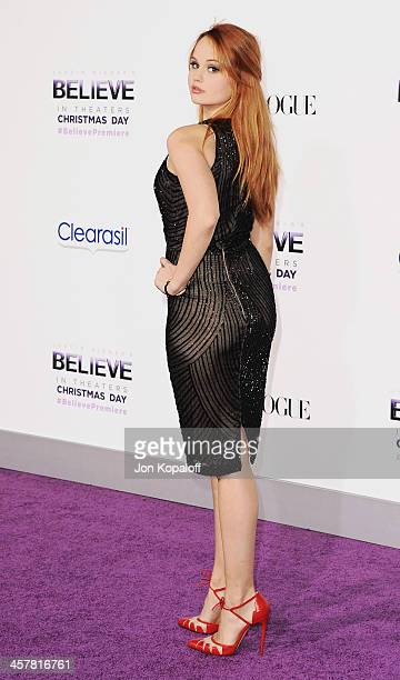Actress Debby Ryan arrives at the Los Angeles Premiere Justin Bieber's Believe at Regal Cinemas LA Live on December 18 2013 in Los Angeles California