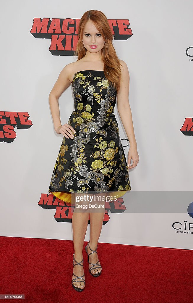 Actress Debby Ryan arrives at the Los Angeles premiere of 'Machete Kills' at Regal Cinemas L.A. Live on October 2, 2013 in Los Angeles, California.