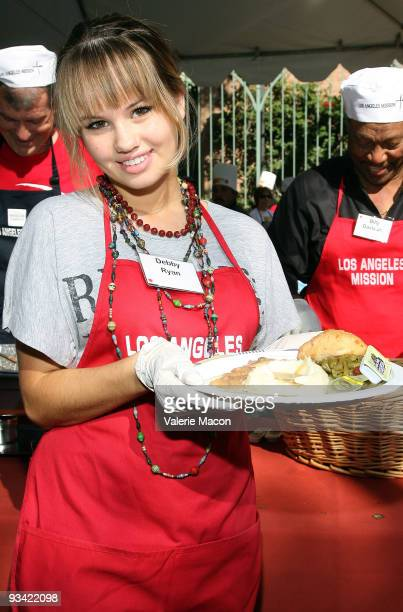 Actress Debby Ryan attends the Los Angeles Mission Thanksgiving meal for the homeless at Los Angeles Mission on November 25 2009 in Los Angeles...
