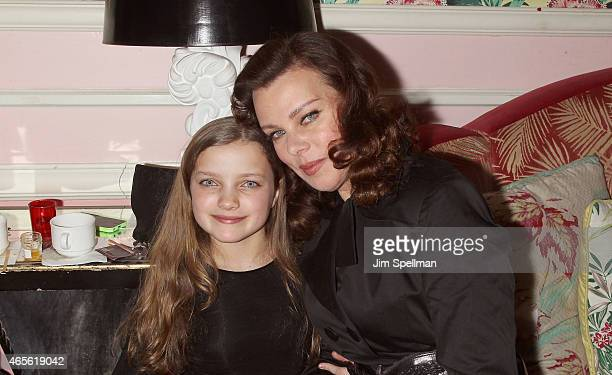 Actress Debi Mazar and daughter Giulia Isabel Corcos attend a screening of Disney's Cinderella hosted by The Cinema Society and Stuart Weitzman at...