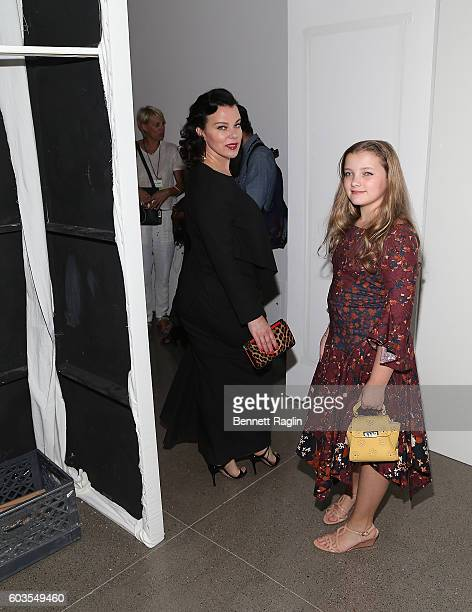 Actress Debi Mazar and daugther Giulia Isabel Corcos attend the Zac Posen fashion show during New York Fashion Week at Spring Studios on September 12...