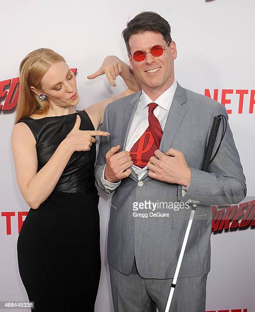 Actress Deborah Ann Woll and EJ Scott arrive at the premiere Of Netflix's Marvel's Daredevil at Regal Cinemas LA Live on April 2 2015 in Los Angeles...