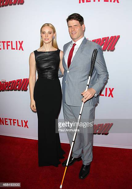 Actress Deborah Ann Woll and EJ Scott attend the premiere of Marvel's Daredevil at Regal Cinemas LA Live on April 2 2015 in Los Angeles California