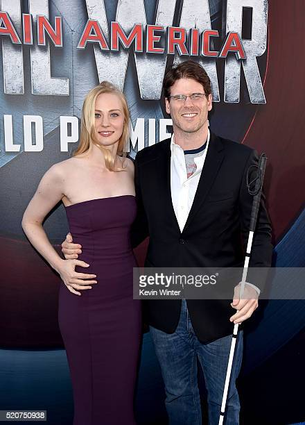 Actress Deborah Ann Woll and EJ Scott attend the premiere of Marvel's Captain America Civil War at Dolby Theatre on April 12 2016 in Los Angeles...