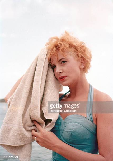 Actress Deborah Kerr poses for a portrait in a bathing suit in 1955 n