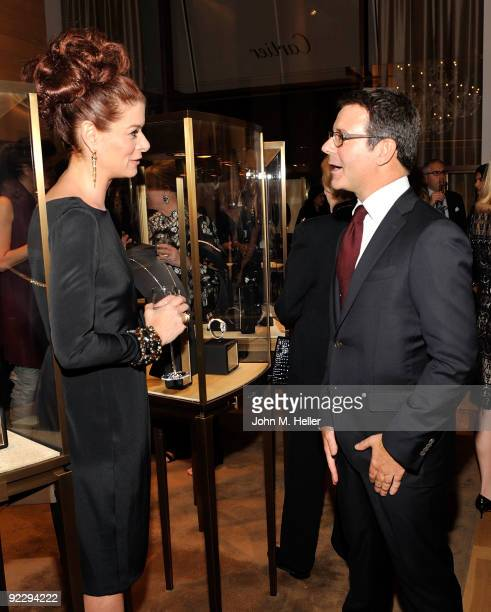 Actress Debra Messing and Cartier director of image style and heritage Pierre Rainero attend the Rodeo Drive Walk Of Style held at the Cartier...