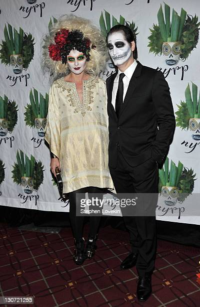 Actress Debra Messing and husband actor/screenwriter Daniel Zelman attend the 16th Annual Bette Midler's New York Restoration Project's Hulaween at...