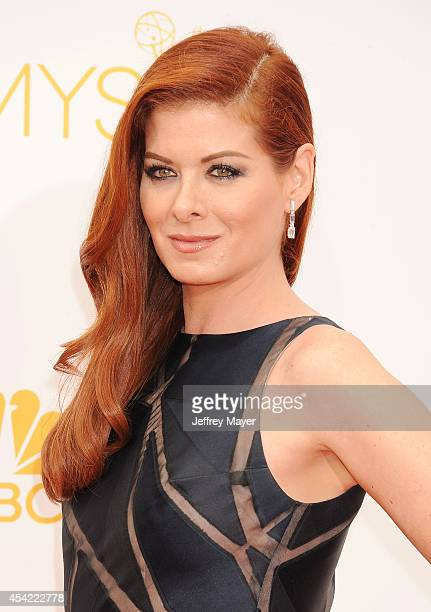 Actress Debra Messing arrives at the 66th Annual Primetime Emmy Awards at Nokia Theatre LA Live on August 25 2014 in Los Angeles California