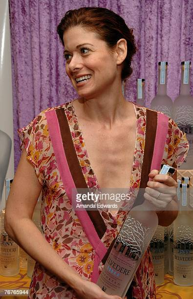 Actress Debra Messing clutching her Belvedere Vodka bottle at the Belvedere Vodka Beauty Bar at the HBO Luxury Lounge held at The Four Seasons Hotel...