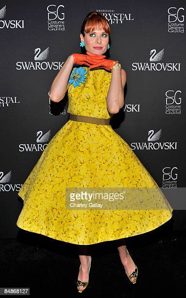 Actress Debra Messing poses backstage during the 11th annual Costume Designers Guild Awards held at the Four Seasons Beverly Wilshire Hotel on...